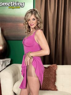 Mature Woman Cami Cline Doffs Her Dress To Model In Crotchless Pantyhose