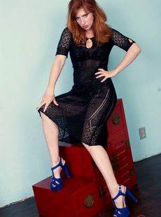Experienced Redhead Amber Dawn Undresses To Show Her Trimmed Snatch