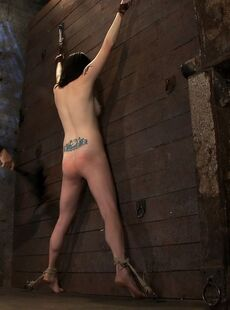 Naked Female Scarlet Faux Is Caned Until She Turns Red In A Dungeon